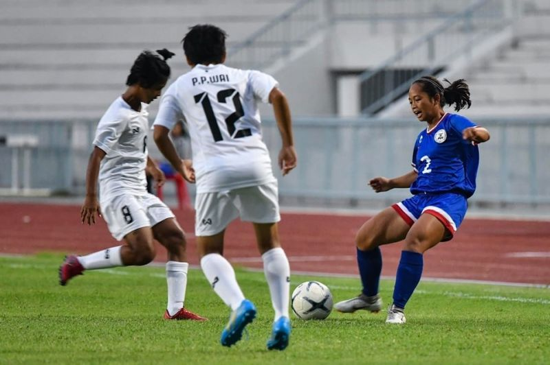 THAILAND. A striker from the Philippines (right) is up against two Myanmar defenders in their group A game held Sunday, May 12, in the ongoing Asean Football Federation (AFF) U15 Girls Championship 2019 at the Gymnastics Institute Chonburi Campus, Thailand. Philippines won this one, 5-0. (Photo from FA Thailand Facebook page)
