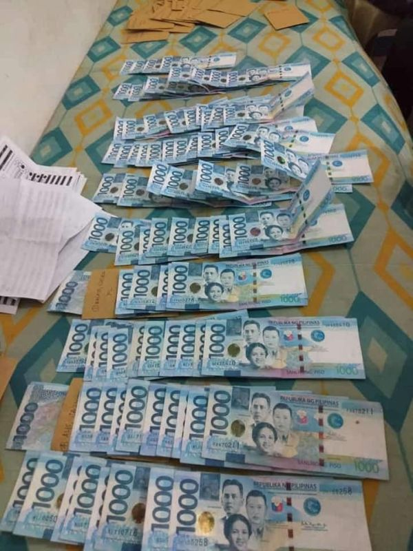 BACOLOD. Sample ballots with a total of P127,000 cash were recovered by E.B. Magalona Police from two persons at Barangay Tuburan in the said town this morning. (Contributed photo)