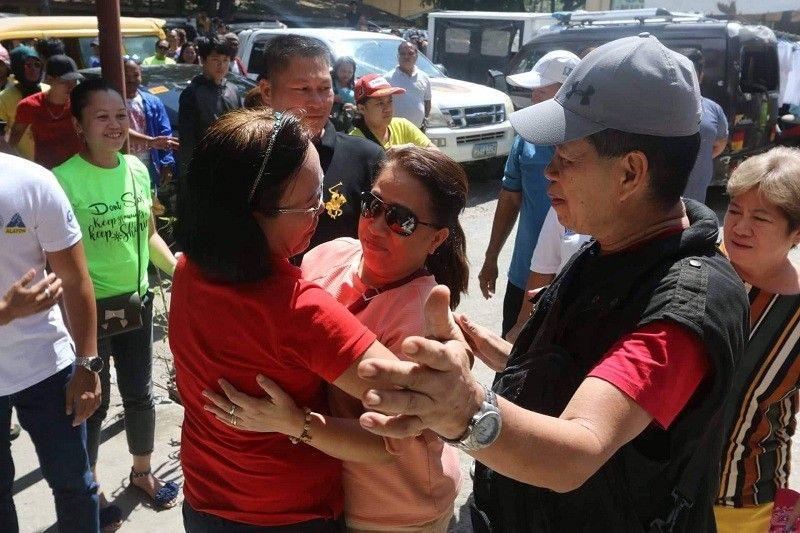 CEBU. A supporter hugs incumbent San Fernando, Cebu Mayor Lakambini Reluya, who is leading in the poll results. San Fernando has been identified as an election hotspot. (Alex Badayos)