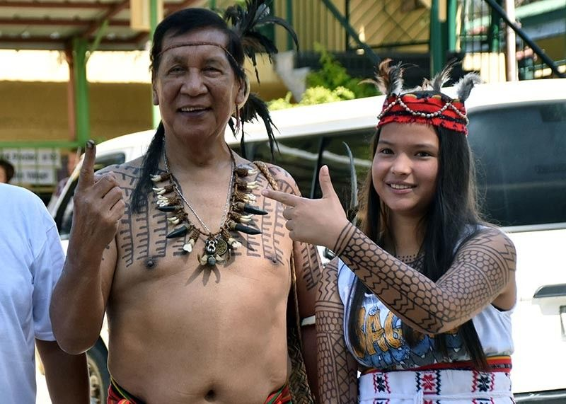 BAGUIO. Bontoc elder Bong Cawed, accompanied by his granddaughter Chandra Danglipen, casts his vote in his traditional cultural attire during the midterm elections at the Sped Center in Baguio City Monday, May 13, 2019. (Redjie Melvic Cawis)