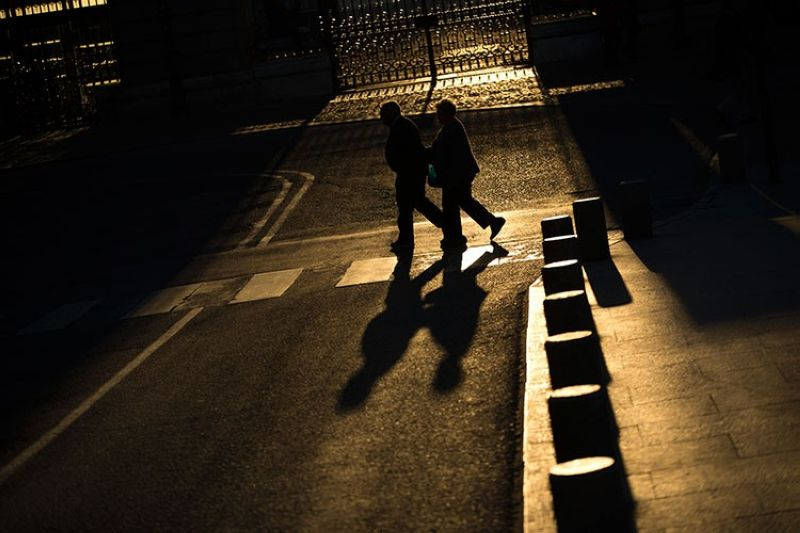 SPAIN. In this April 4, 2017 file photo, an elderly couple walks across a street near the Royal Palace in Madrid. If you want to save your brain, focus on keeping the rest of your body well with exercise and healthy habits rather than popping vitamin pills, say new World Health Organization guidelines for preventing dementia, released on Tuesday, May 14, 2019. (AP)