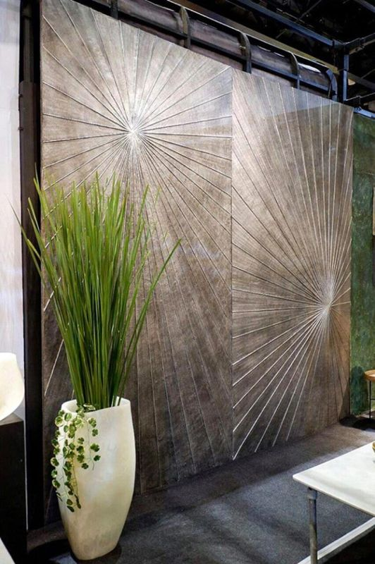 SUNBURST WALL DECAL. The wall decal looks heavy, but it is not, being made of recycled paper composite called Nucast. (Contributed photo)