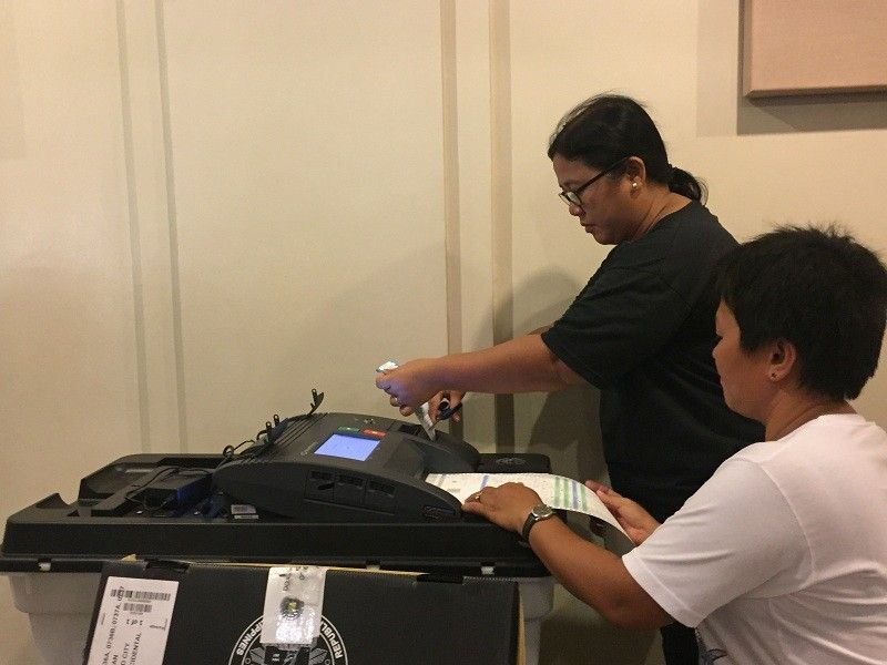 BACOLOD. The Board of Elections and Inspectors assigned at Pagla-um Elementary School conducts the final testing and sealing of vote counting machines at the Bacolod Government Center on Wednesday, May 15. (Merlinda Pedrosa)