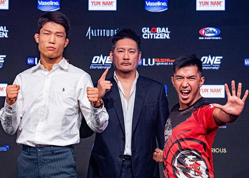 "DAVID AND GOLIATH. Team Lakay's Geje Eustaquio face off for the first time against six footer South Korean Kim Kyu Sung as they clash in an alternate grand prix bout in the fight card of the ""Enter the Dragon"" tonight at the Singapore Indoor Stadium. (ONE photo)"