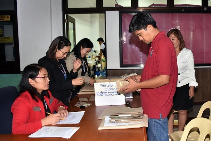 COMELEC election officers in the different Benguet municipalities turns over the election returns and other election paraphernalia used during the conduct of the May 13, 2019 National and Local Elections at the Provincial Board of Canvassers at the Benguet Provincial Capitol on Tuesday, May 14, 2019. (RMC PIA-CAR)