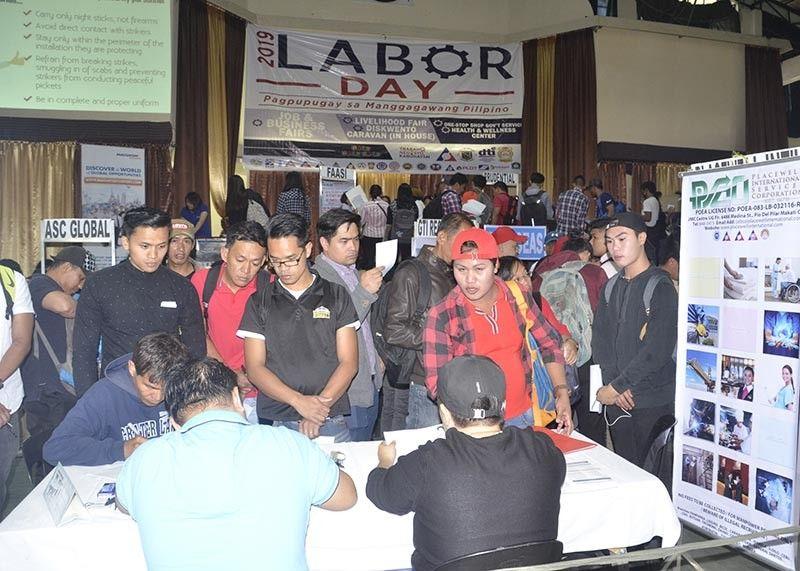BAGUIO. Some 2,401 job applicants registered for local and overseas employment during the Labor Day Jobs Fair at the Baguio City National High School recently. The Department of Labor and Employment recently earmarked P18.88 million for this year's Special Program for Employment of Students (SPES) in the Cordillera Administrative Region. (Photo by Lito Dar)