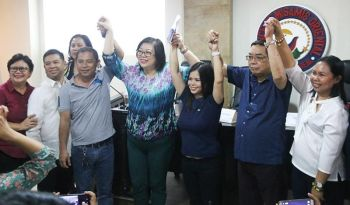 CAGAYAN DE ORO. The Provincial Board of Canvassers proclaims reelected Second District Representative Juliette Uy along with Provincial Board member-elect Jessa Mugot. (Alwen Saliring)