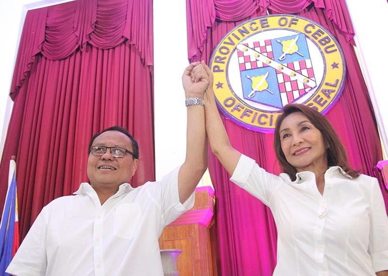 ELECTION WINNERS. Governor-elect Gwendolyn Garcia and her brother Pablo John Garcia, for congressman 3rd district, couldn't be happier raising each other other's hands. (SunStar photo / Amper Campaña)