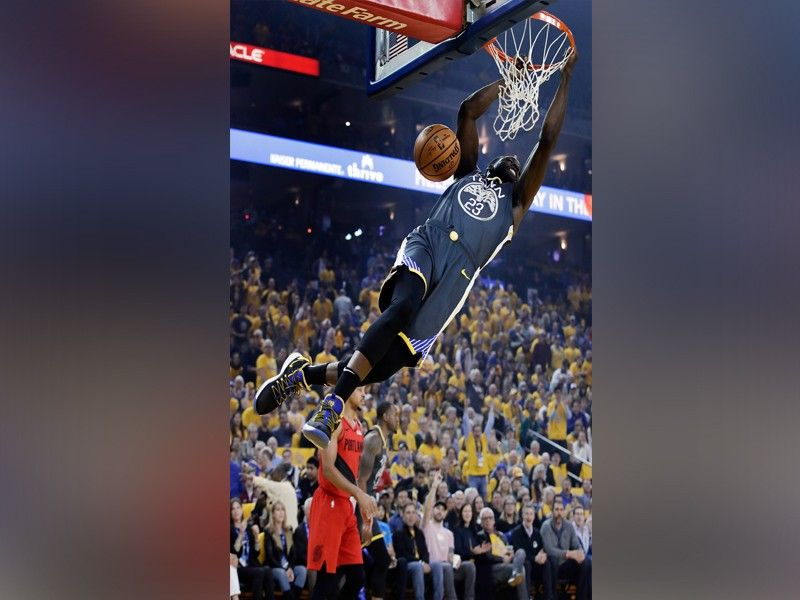 Golden State Warriors' Draymond Green scores against the Portland Trail Blazers during the first quarter of Game 2 of the NBA basketball playoffs Western Conference finals Thursday, May 16, 2019, in Oakland, Calif. <b>(AP)</b>