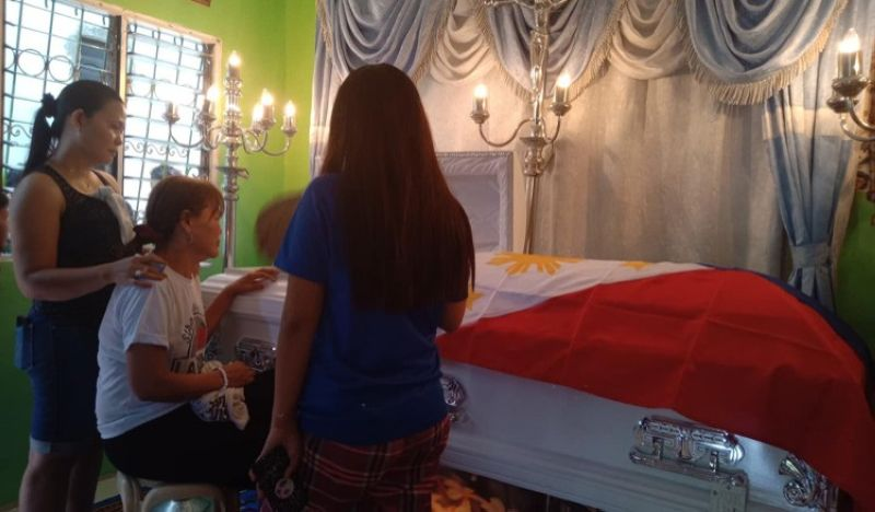 CEBU. Anecita Bartilic (in white shirt) is comforted by her relatives as she looks at the coffin of her husband, slain Lawaan 3 village chief Jimmy Bartilic. Jimmy was one of three men killed in a fatal shooting incident in Barangay Lawaan 3, Talisay City last Thursday, May 16. (SunStar photo/ Wenilyn B. Sabalo)