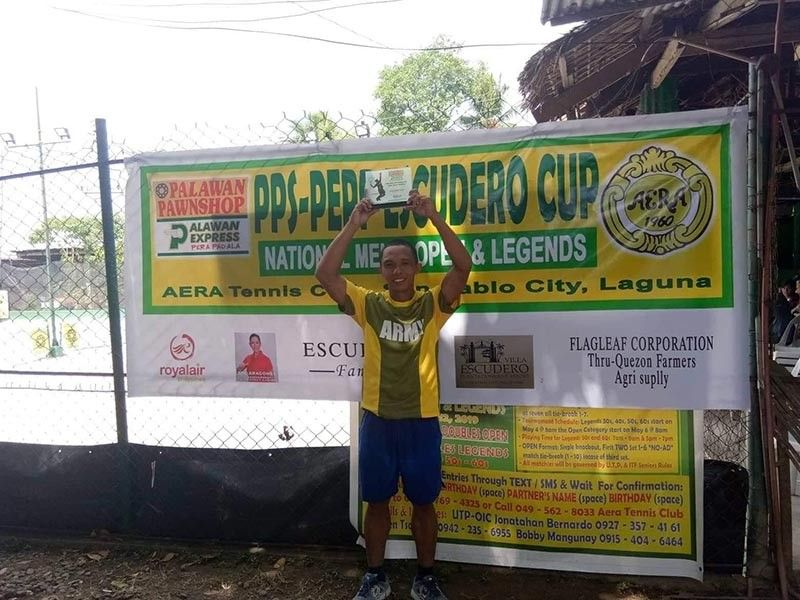TWIN KILL. Mark Anthony Alcoseba of Davao City captures the men's singles and men's doubles of the PPS-PEPP Escudero Cup held at the Aera Tennis Club in San Pablo City recently. (Contributed photo)