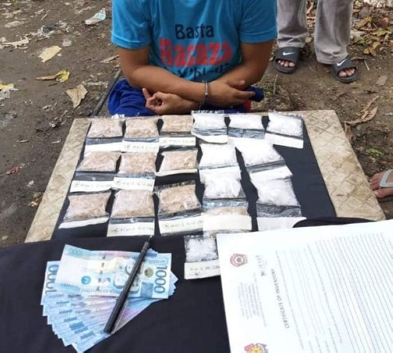 EVIDENCE. Police present several packs of white and brown shabu and the cash seized from suspect Marvin Saberon during a drug bust in Mabolo, Cebu City. (Contributed foto / CCPO)