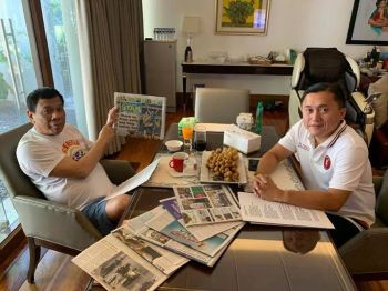 MANILA, In this photo posted by probable senator-elect Christopher Go on his Facebook account on Sunday, May 19, President Rodrigo Duterte points to the front page of a newspaper as proof of life amid rumors to he was rushed to the hospital. (File Photo)