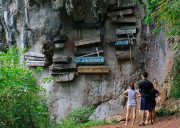 SAGADA. Tourists are in awe of the pinewood coffins suspended with primitive wires and ropes along limestone known as the hanging coffins' of Echo Valley in Sagada, Mountain Province. Photo by Jean Nicole Cortes