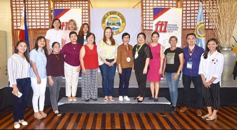 BACOLOD. Tourism assistant secretary Ma. Rica Bueno (6th from right) with DOT-Western Visayas director Helen Catalbas (5th from right), provincial supervising tourism operations officer Cristine Mansinares (4th from right) and tourism officers in the province during the opening of Future Tourism Leaders Camp held at the Provincial Capitol's Social Hall in Bacolod City. (Contributed photo)