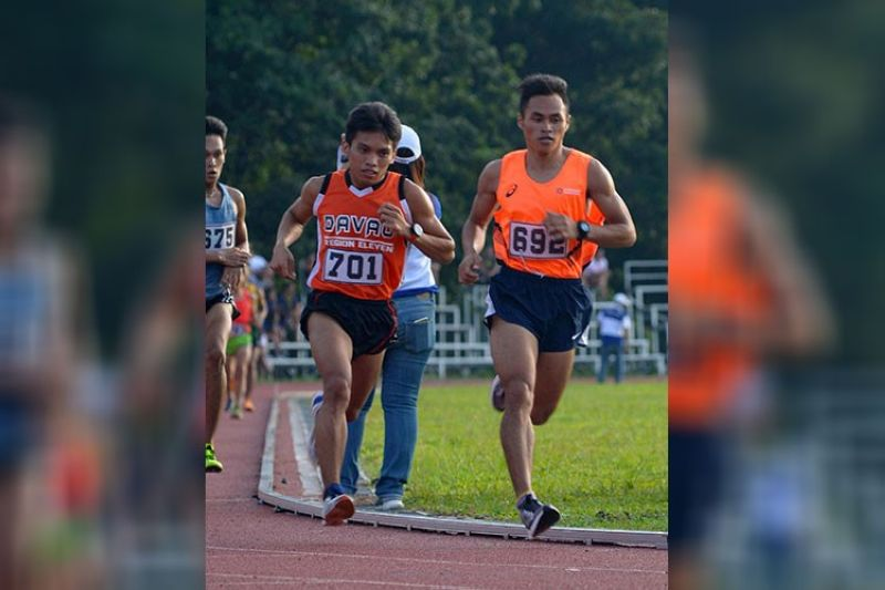 DAVAO. Arlan Arbois (692) and Fritz Clarence Lantaco (701) of Davao race to claim the gold and silver medals, respectively, in the National Prisaa Games 2019 college men's 5,000-meter run at the University of Mindanao track oval in Matina, Davao City on Tuesday, May 21, 2019. (Darwin Malmis Ponce/UM)