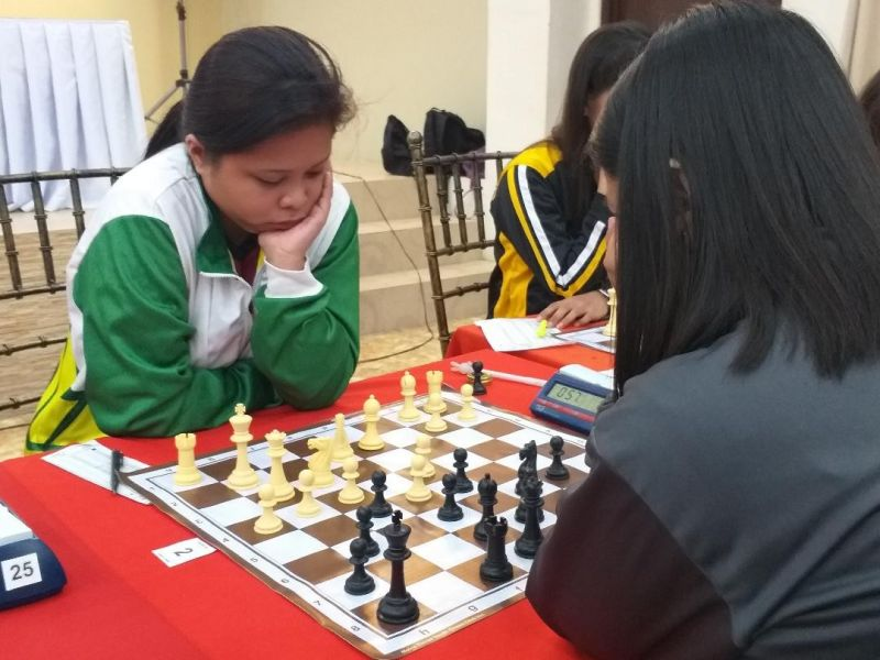 DAVAO. Honey Grace Buenafe of Davao (left) studies her next move against Aira Olleta of Bicol during their National Prisaa Games 2019 college women's third round match at the Sofia Hall of the Agro-Industrial College of the Philippines Tuesday, May 21, 2019. The Dabawenyo won to stay unbeaten in three outings. (Marianne L. Saberon-Abalayan)