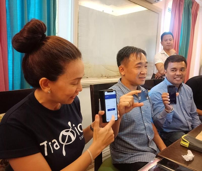 DAVAO. (From left) TraXiaon on CEO Ann Cuisia, NCCC CEO Lafayette Lim and NCCC chief financial officer Sonny Catacutan show the Ka-Coop Card and its mobile application. (Lyka Casamayor)