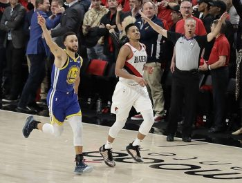 Golden State Warriors guard Stephen Curry, left, celebrates as he runs next to Portland Trail Blazers guard CJ McCollum, center, at the end of Game 4 of the NBA basketball playoffs Western Conference finals, Monday, May 20, 2019, in Portland, Ore. The Warriors won 119-117 in overtime. <b>(AP)</b>