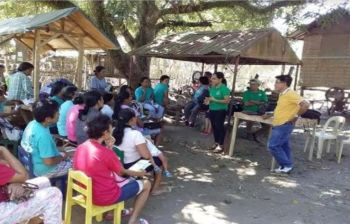 BACOLOD. Members of the quick response team of the Provincial Veterinary Office conduct an information and education campaign to the residents of Barangay Bagroy in Binalbagan town, within the five-kilometer radius, following the suspected human rabies death in the area. (Contributed Photo)
