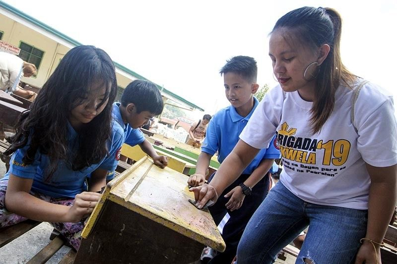 BAGUIO. Volunteers, government employees, parents, teachers, students and other stakeholders work hand in hand to clean, scrub chairs and paint classrooms at the Baguio Central School to support the Department of Education's