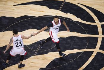 Toronto Raptors forward Norman Powell (24) celebrates his basket with Fred VanVleet (23) during the second half of Game 4 of the team's NBA basketball playoffs Eastern Conference finals against the Milwaukee Buck, Tuesday, May 21, 2019, in Toronto. <b>(AP)</b>