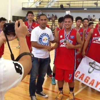 CAGAYAN DE ORO. Jerome Menaling is seen here congratulated by local NBTC-D League head Arvin Martinez during his junior days with the Sacred Heart Saints of coach Boy Dacoco. (Supplied Photo)