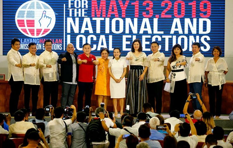 MANILA. Ten of the 12 newly-proclaimed Philippine senators make a President Rodrigo Duterte fist bump gesture during proclamation ceremony in Pasay City Wednesday, May 22, 2019. (AP)