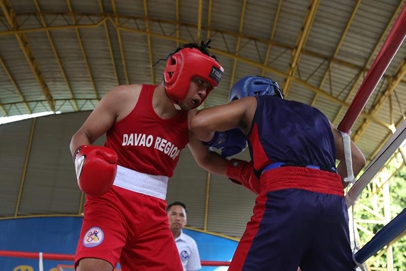 DAVAO. Paul Julyfer Celis Bascon unleashes a left hook against Romel Bale of Soccsksargen enroute to winning Davao region's lone boxing gold medal in college men's middleweight event at the Almendras Gym Davao City Recreation Center late Wednesday afternoon, May 22, 2019. (Photo by Mark A. Perandos)