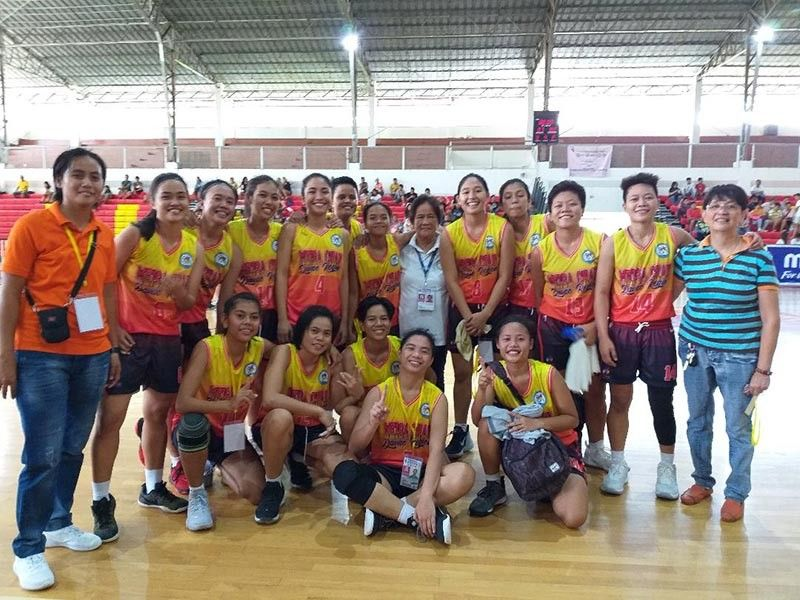 DAVAO. Defending champion Davao region women's basketball team poses with National Prisaa president Ma. Lita Montalban after beating Calabarzon, 87-80, in a come-from-behind fashion in the semifinals at the University of Mindanao (UM) Matina Gym, Davao City Thursday, May 23, 2019. (Photo by Marianne L. Saberon-Abalayan)