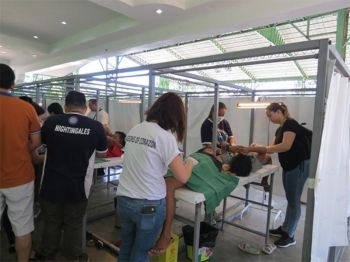 BACOLOD. The medical mission held at Sea Breeze Park, Valladolid, Negros Occidental on April 14. Mrs. Olivia V. Yanson, matriarch attended the said activity and was welcomed by Valladolid Mayor Enrique Miravalles. (Contributed photo)