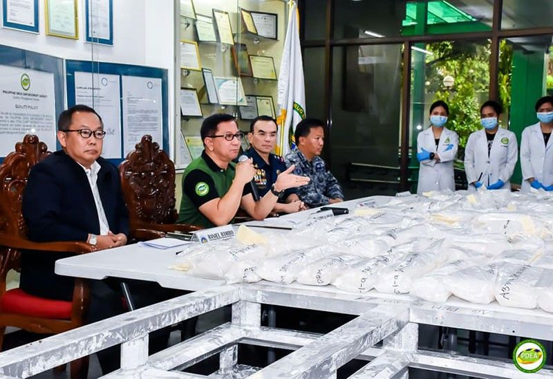 MANILA. Officials present 114 bags of methamphetamine hydrochloride (shabu) weighing a total of 146 kilos and valued at about P1 billion on Friday, May 24, 2019. (Photo from PDEA)