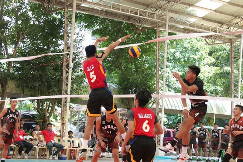DAVAO. Best attacker Rex Paller of Davao region (No. 4) spikes against a Calabarzon region defender during the college men's volleyball finals at the University of Mindanao covered court in Matina, Davao City Friday, May 24, 2019. (Mark Perandos)