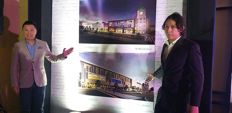 BACOLOD. Megaworld Corp. chief strategy officer Kevin Tan (left) and Architect Raji Casas unveil the perspective of the P1.2 billion Upper East Mall during the media briefing at L'Fisher Hotel in Bacolod City Friday, May 24, 2019. (Erwin P. Nicavera)