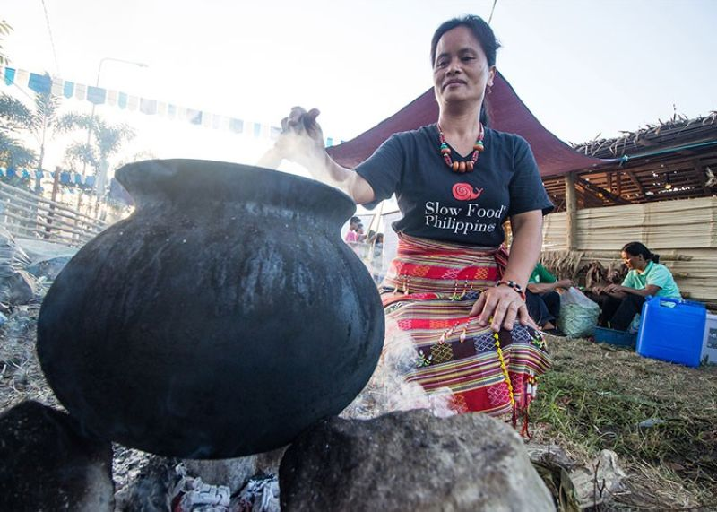 KALINGA. Women from Pasil in Kalinga demonstrate slow food cooking promoted by Slow Food International, a global, grassroots organization, founded in 1989 to prevent the disappearance of local food cultures and traditions, counteract the rise of fast life and combat people's dwindling interest in the food they eat. (Jean Nicole Cortes)