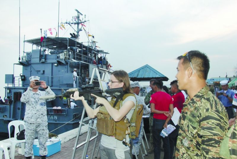 Opening Salvo: Guests test firearms of the Philippine Navy during the opening of the Gabii sa Kabilin at the Aduana Port in Cebu City on Friday night, May 24, 2019. (SunStar Photo/ Amper Campaña)
