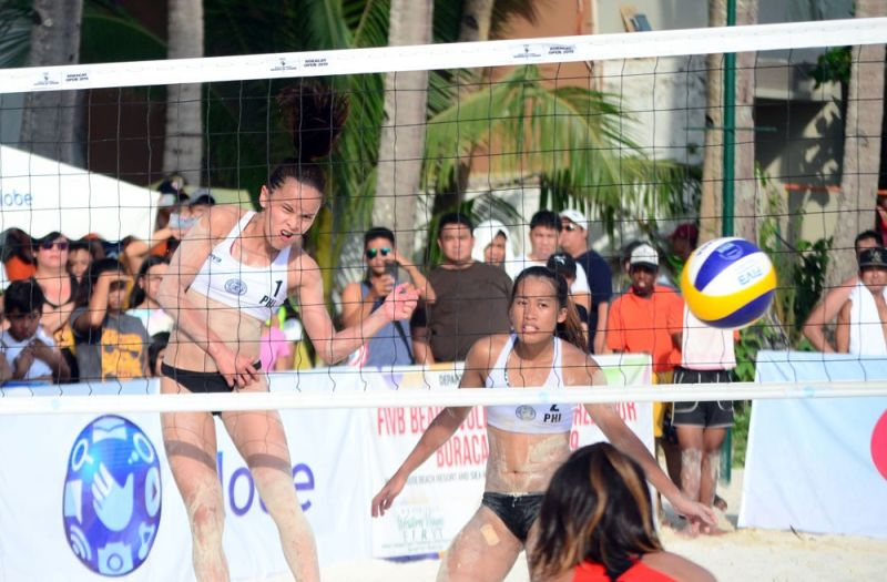 BLOCK THIS. Sisi Rondina (left) scores on a spike against Japan in the quarterfinal round of the Boracay Open. (Contributed foto)