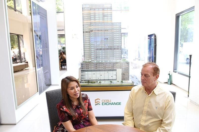 WHAT'S NOT TO LIKE? Azpired president and chief executive officer Almira Absin (left) says the large cuts of the Cebu Exchange and its location attracted them to move their offices. With her is Azpired chairman Scott Johnson. (Contributed photo)