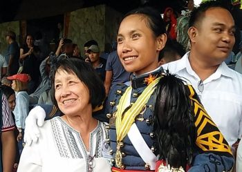 BAGUIO. Second Lieutenant Dionne Mae Apolog Umalla with mother Dionisia after the PMA graduation rites for Mabalasik Class of 2019. (Lauren Alimondo)