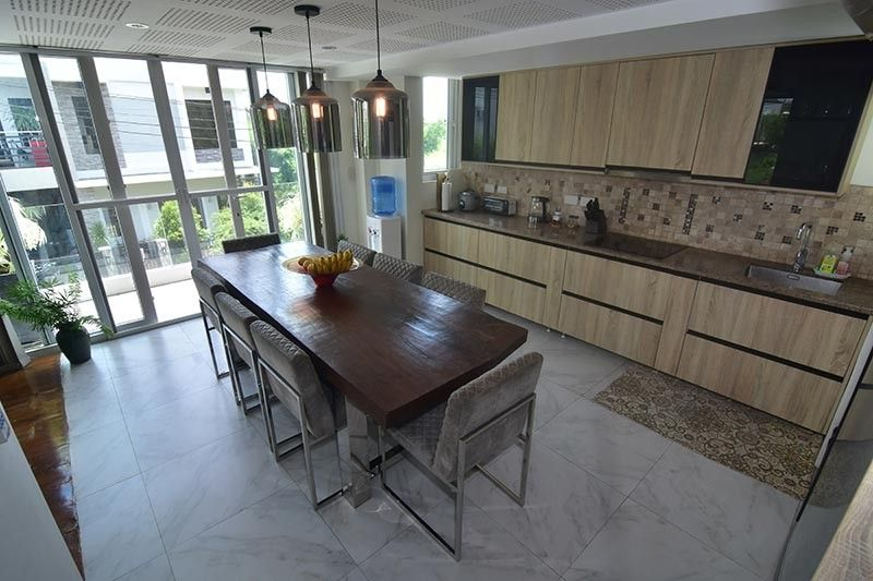 DAVAO. Molly's kitchen has veneered wood cabinets and granite countertops furnished by Mobelhaus Philippines, Inc. one of the most sought-after and reliable makers of high quality kitchens and closets using state-of-the-art German technology. (Contributed photo)