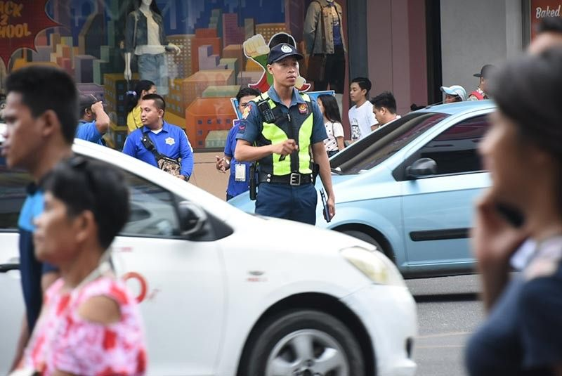 POLICE VISIBILITY. Since May 26, 2019, all police personnel from Cebu City's 11 police stations have been rendering at least two hours of traffic duty during rush hour. (SunStar photo / Allan Cuizon)