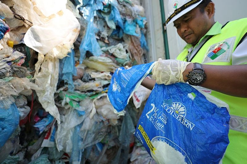 MALAYSIA. Officers from the Ministry of Environment examine a container full of non-recyclable plastic which was detained by authorities at the west port in Klang, Malaysia, Tuesday, May 28, 2019. (AP)