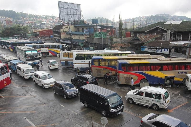 BAGUIO. Buses bound to the different parts of Luzon utilize Gov. Pack Road as a central terminal. Baguio Representative Mark Go has joined the opposition in the proposed provincial bus ban along EDSA. (Photo by Jean Nicole Cortes)
