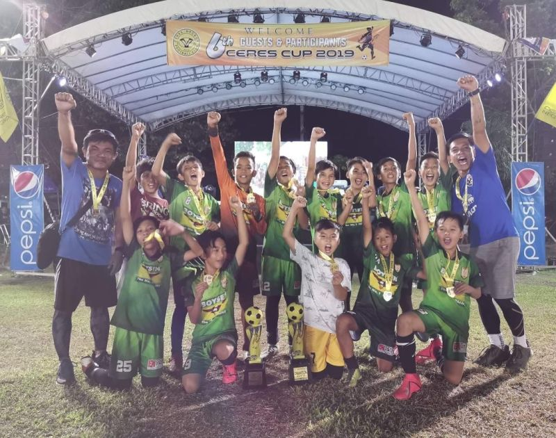 DAVAO. The Rovers Football Club Davao under-12 team players and coaches celebrate their championship victory in the recently-concluded 6th Ceres Cup 2019 Football Tournament held recently in Bacolod City. (Contributed photo)