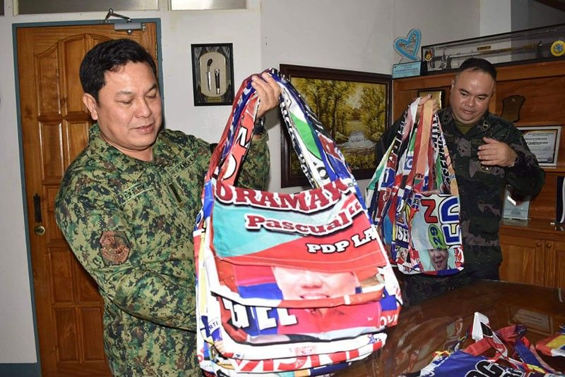CARAGA. Brigadier General Gilberto Cruz, Caraga Police regional director, show the upcycled bags made of campaign materials. (Photo from Caraga police)