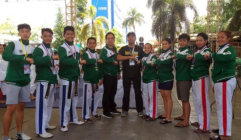 DAVAO. University of the Cordilleras taekwondo team is joined by athletic director Danny Cong-o and coach Danrey Velo after snatching two golds, three silvers, and three bronze medals during the recently concluded PRISAAA 2019 National games in Davao. (Contributed photo)