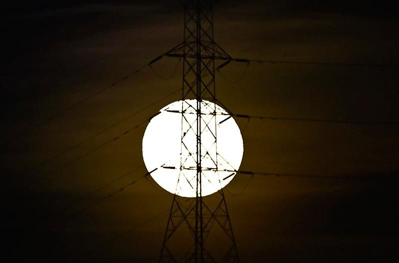 TOWER AGAINST THE LIGHT OF THE MOON. The Regional Development Council 7 has sought presidential intervention to include the Cebu-Negros-Panay and Cebu-Bohol backbone projects as energy projects of national significance. (SunStar file)