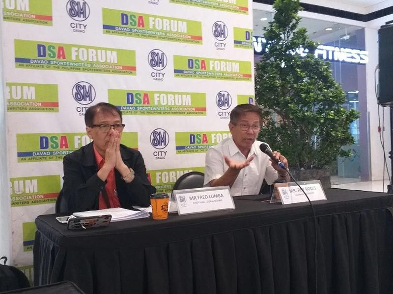 AMBITIOUS. Red Boxing International, Inc. chairman Rey Rodis, right, and Global Boxing Organization chairman Fred Lumba, guests during yesterday's Davao Sportswriters Association (DSA) Forum at The Annex of SM City Davao, will bring an ambitious boxing event here dubbed as Thrilla in Davao slated June 15. (Marianne L. Saberon-Abalayan)