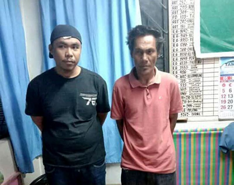 DAVAO. Abu Sayyaf bandits Haider Arasani Anjawang and Al Faisal Abubakar Hassan were arrested in Davao City Wednesday, May 29, 2019. (Photo courtesy of Bunawan Police Station)