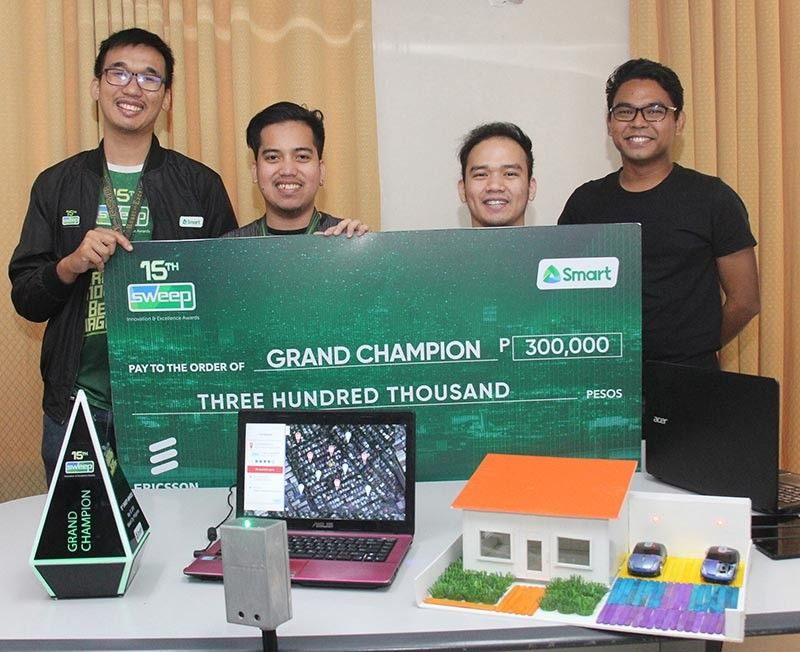 WINNERS. (From left) USJ-R's Noel Daniel Seldura (left), Kevin Cerdon, Jesury Thomas Gadiane and Eric Magto pose for posterity with the CarSpace model app, the prize check and the trophy for being proclaimed grand champion in the recent 15th Sweep Innovation and Excellence Awards 2019. (SunStar photo / Amper Campaña)